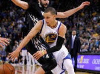Golden State Warriors guard Stephen Curry (30) passes the ball around Minnesota Timberwolves guard Ricky Rubio in the fourth quarter at Oracle Arena. The Timberwolves defeated the Warriors 121-120.