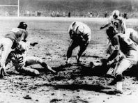 Baltimore fullback Alan Ameche plunges through a hole in the Giants' defense for a 1-yard touchdown, giving the Colts a 23-17 sudden-death overtime win in the NFL championship game at Yankee Stadium on Dec. 28, 1958.