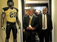 New Vanderbilt football coach Derek Mason, left, and athletics director David Williams walk in the hallway to a press conference Saturday at McGugin Center.
