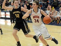 Hendersonville High's Elizabeth Burns (44) drives past Beech defender Ashtin Banks during the first quarter of Tuesday's game. Burns scored eight points as the Lady Commandos defeated Beech 51-38.