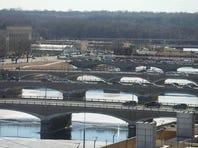 Traffic crosses the Des Moines River on the Grand Avenue bridge, foreground. Some city officials fear losing the bridge's arches when it's replaced.