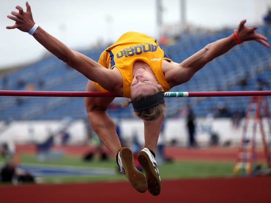 Kami Norton flies over the bar during the high jump