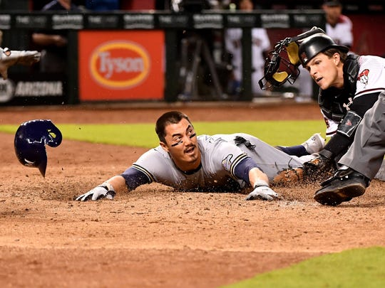 Brewers second baseman Tyler Saladino safely dives