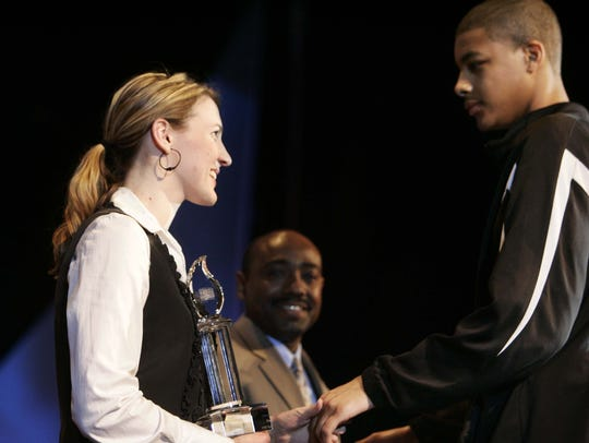 Kaia Jergenson presented Siegel basketball player Neal Carroll III with the Kaia Jergenson Courage Award at the 10th Annual O'Charley's Dinner of Champions in 2008.