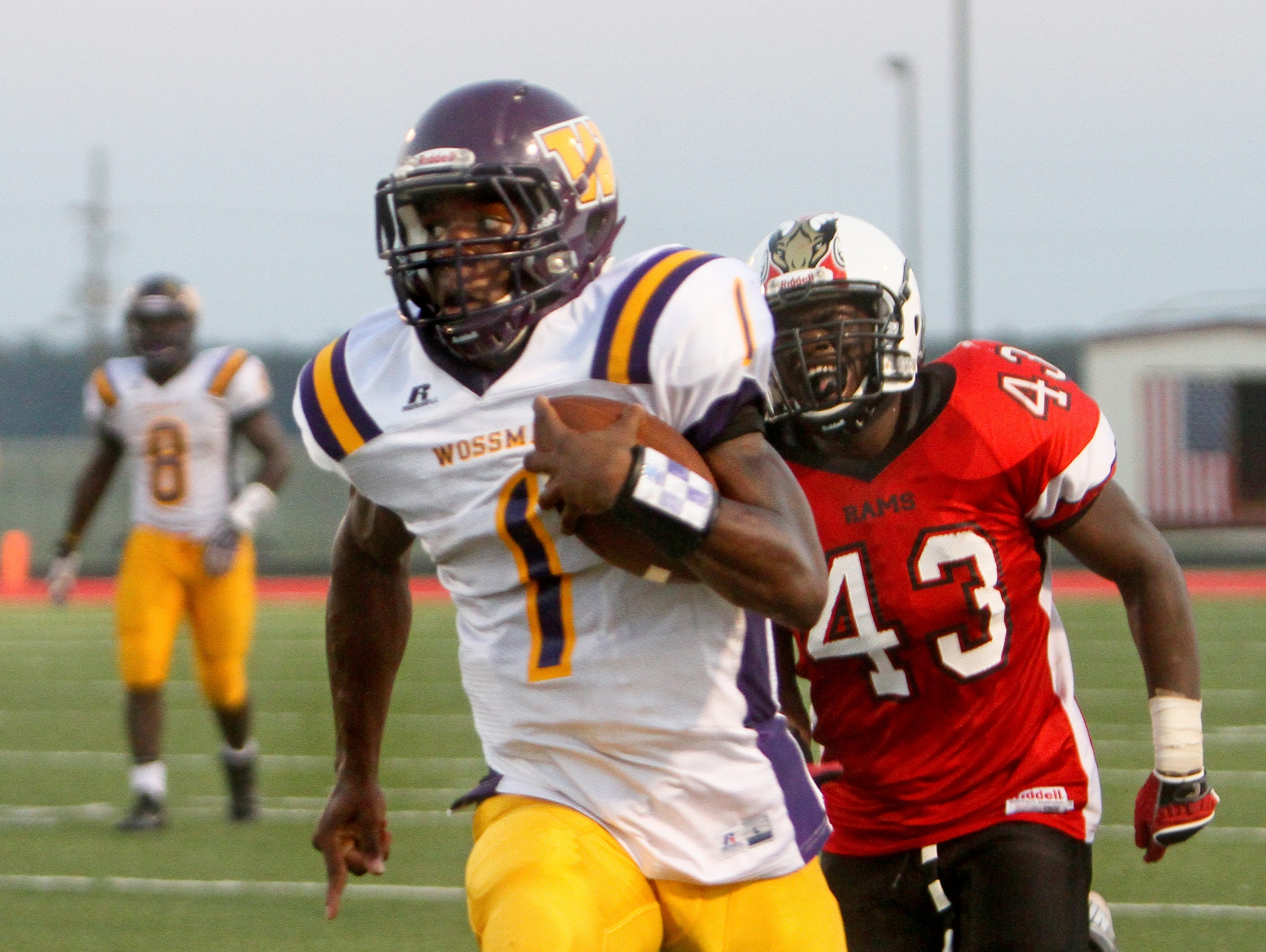 Wossman QB Cameron Lewis (1) outruns Richwood's Tyquan Pleasant (43) and into the end zone for the first touchdown against the Rams.
