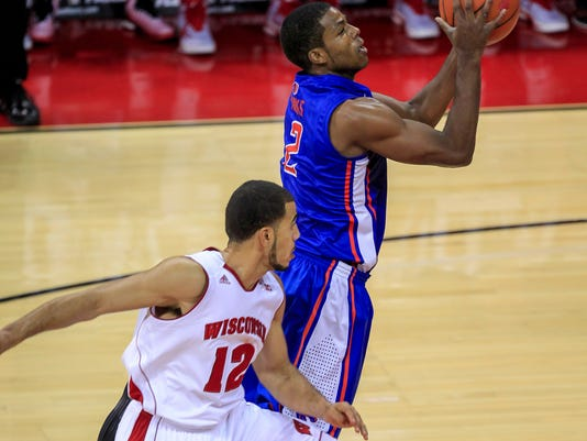 Boise State's Kevin Allen shoots past Wisconsin's Traevon Jackson (12) during the first half of an NCAA college basketball game Saturday, Nov. 22, 2014, in Madison, Wis. (AP Photo/Andy Manis)