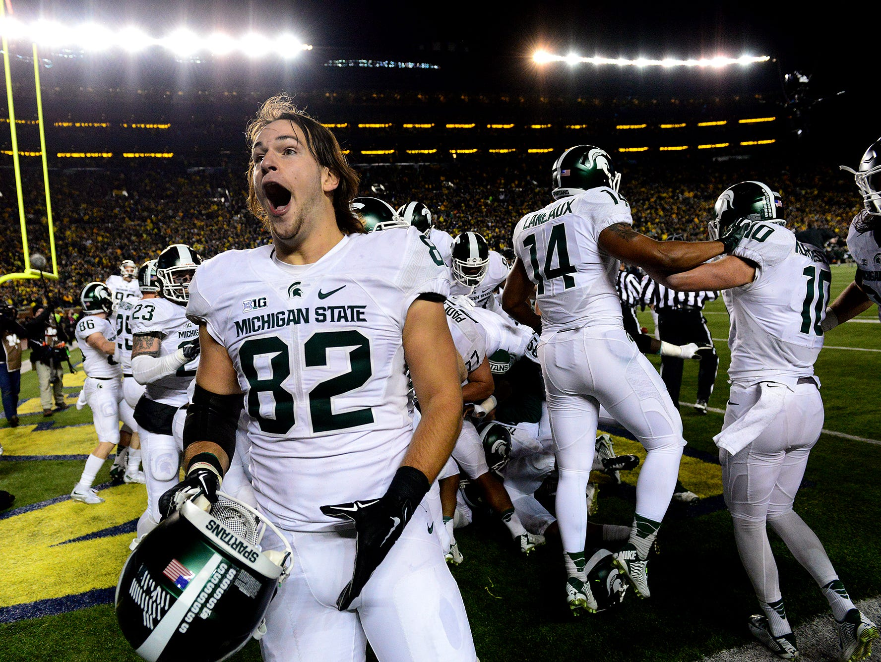 Michigan State tight end Josiah Price screams as he celebrates with teammates after a thrilling, last-second 27-23 victory over Michigan Saturday in Ann Arbor.