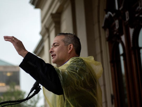 Paulo Gordillo speaks during a rally held by the Lansing