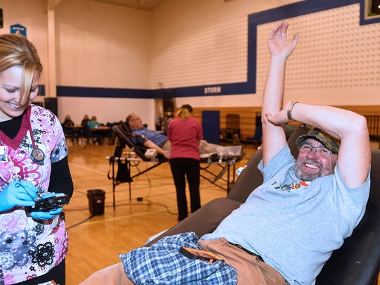 Long-time blood donor Ted Brauer of Sturgeon Bay donates blood Tuesday during an American Red Cross Blood Drive at St. Peters Evangelical Luheran Church, 108 W. Maple St. , Sturgeon Bay. Blood bank worker Courtney Kinjerski of Kewaunee drew the blood.