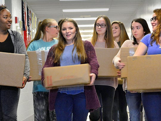 Students in the Volunteer Club at Dallastown help carry