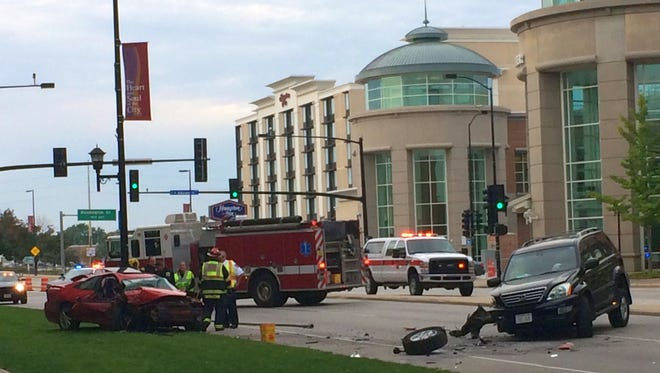 Responders from the Green Bay Metro Fire and Police departments work at the scene of a two-vehicle crash on Main Street in front of the KI Convention Center in downtown Green Bay on Thursday, Sept. 24.