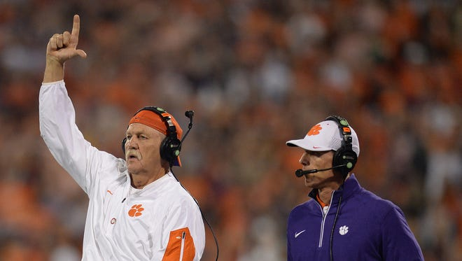 Clemson assistant coach Dan Brooks and defensive coordinator Brent Venables during the 1st quarter Saturday, October 16, 2015 at Clemson's Memorial Stadium.