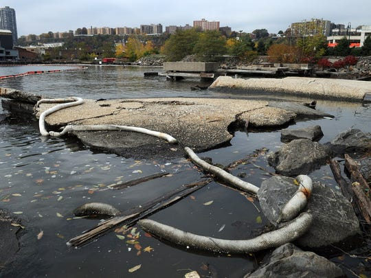 Debris and containment booms in the Hudson River near