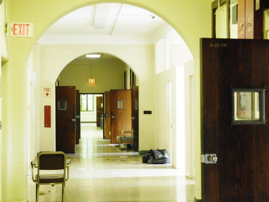 As seen in June 2007, the dormitory rooms feed into a  wide hallway with terrazzo floors, plaster walls and 12 foot ceilings, nevertheless hopelessly outdated for the needs of modern psychiatric care in the Fairview Avenue Building 2 on the 110 year -old 350 -acre Essex County Psychiatric Hospital complex (Overbrook) that was razed.