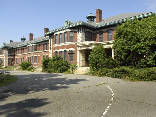 The shingle roof, copper gutters and brick and wood -detailed eastern facade of the Fairview Avenue Building 2 on the 110 year -old 350 -acre Essex County Psychiatric Hospital complex (Overbrook) as seen in June 2007.