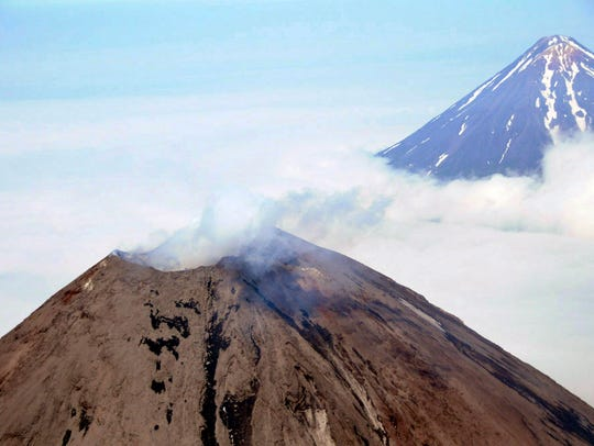 Cleveland Volcano, left, located in the Aleutian Islands