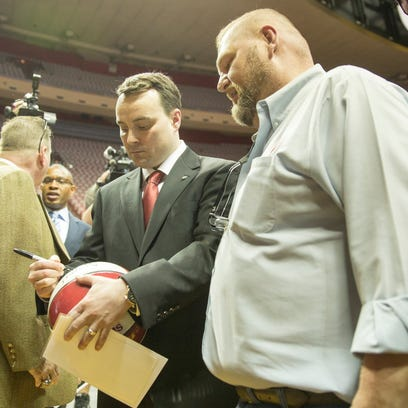 Todd Reid, Bloomington (right), gets the first signature