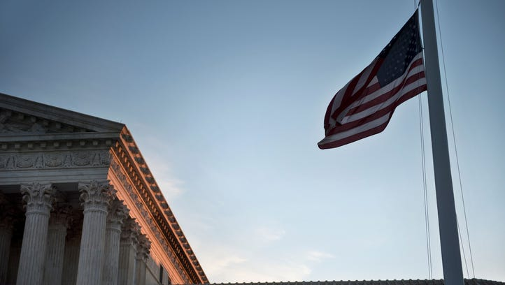 American flag at half staff at U.S. Supreme Court after