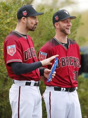 Brad Boxberger stands with fellow reliever T.J. McFarland at spring training last month.