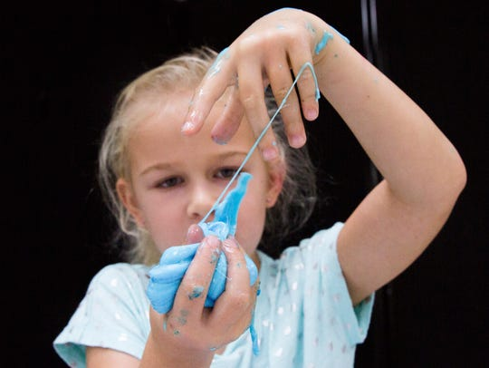 Aeliana West, 6, plays with her slime on Tuesday, June