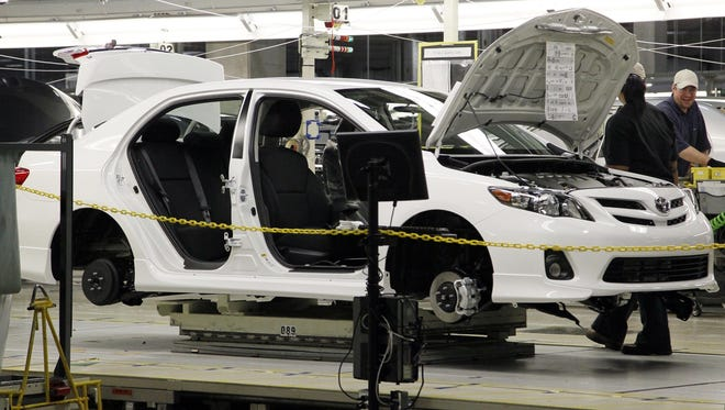 A Toyota Corolla chassis rolls down the assembly line at the Toyota automotive manufacturing facility in Blue Springs. A new study says Mississippi manufacturing jobs pay an average of $.53 more per hour than non-manufacturing jobs.  (AP Photo/Rogelio V. Solis)