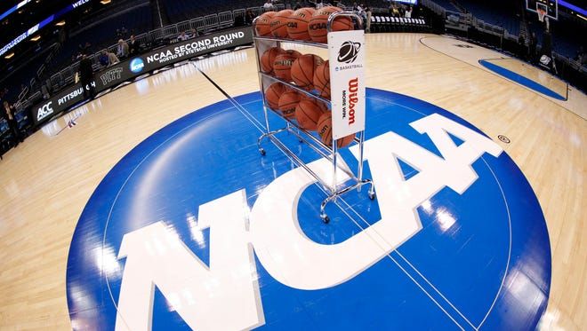 General view of basketballs on the NCAA logo.