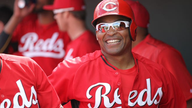 Reds outfielder Marlon Byrd smiles in the dugout after scoring a run against the Cleveland Indians on March 3 in Goodyear.