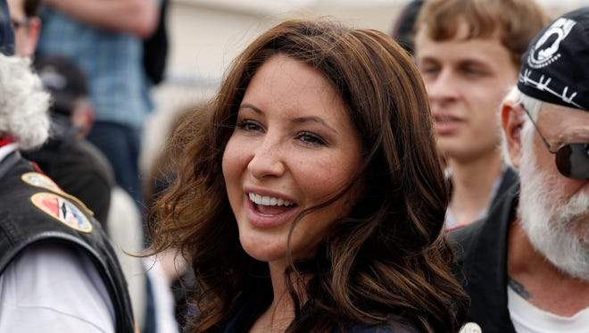 In this May 29, 2011, file photo, Bristol Palin, daughter of former GOP vice presidential candidate and Alaska governor Sarah Palin, smiles at the beginning of the Rolling Thunder ride from the Pentagon during the Memorial Day weekend in Washington.
