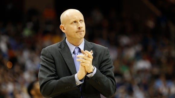 Xavier head coach Chris Mack claps during the final moments of the Musketeers' win against Georgia State in the NCAA tournament.