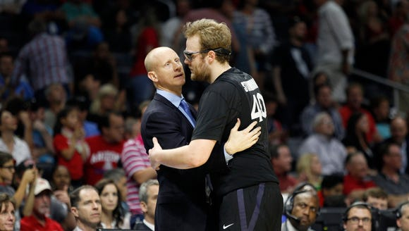 Xavier head coach Chris Mack hugs senior Matt Stainbrook