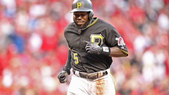 Pirates third baseman and Cincinnati native Josh Harrison scores in the eighth inning on Opening Day against the Reds at GABP.