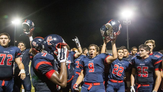 Peoria Centennial celebrates after winning a game against Phoenix Brophy Prep on Sept. 11, 2014.