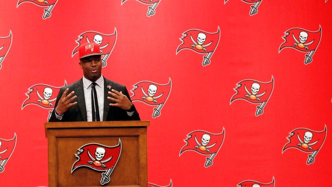 Tampa Bay Buccaneers quarterback Jameis Winston (3) is introduced at a press conference at One Buc Place the day after being selected as the number one overall pick in the 2015 NFL Draft. Mandatory
