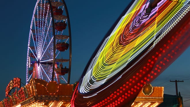 Midway rides are one of the prime attractions at the New York State Fair.