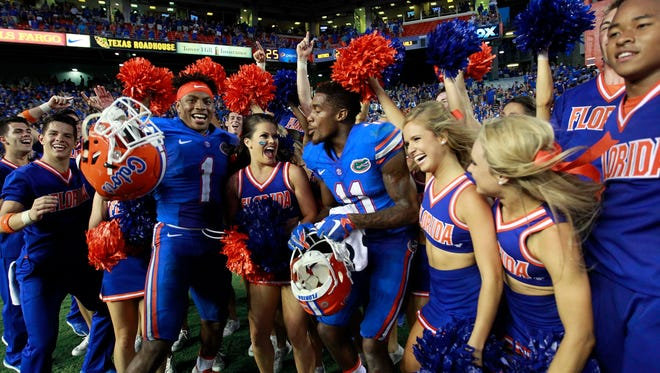 Florida Gators defensive back Vernon Hargreaves III (1) and wide receiver Demarcus Robinson (11) celebrate with the cheerleaders as they beat the Tennessee Volunteers at Ben Hill Griffin Stadium. Florida Gators defeated the Tennessee Volunteers 28-27.