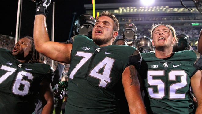 Offensive tackle Jack Conklin celebrates the win over the Oregon Ducks after a game at Spartan Stadium.