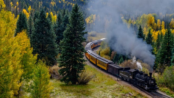A train along the Durango and Silverton Narrow Gauge Railroad passes through fall folliage on its way to Silverton, Colo., on Sept. 29, 2015.