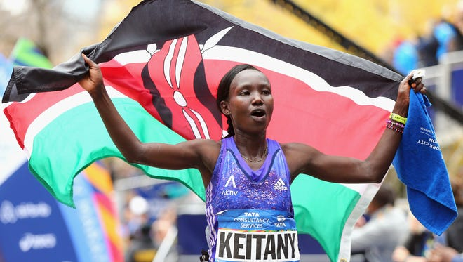 Mary Keitany of Kenya celebrates after winning the Pro Women's division during the New York City Marathon in Central Park