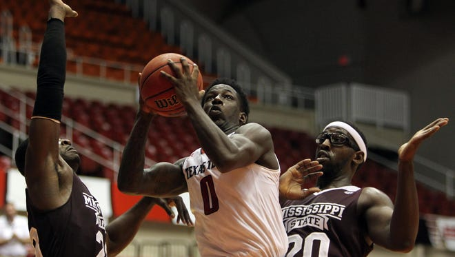 Mississippi State forwards Travis Daniels (23) and Gavin Ware (20) try to defend Texas Tech in their loss Friday.