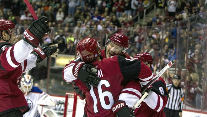 The Coyotes' Max Domi celebrates with Shane Doan after Doan scored a goal against Edmonton in the second period on Nov. 12, 2015.