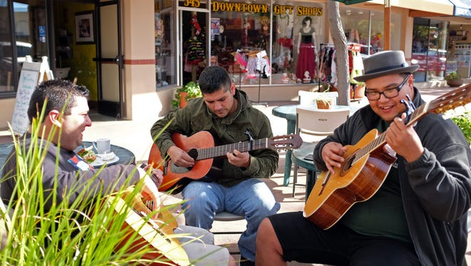 From left, Andrew Gonzalez, 23, Robert Garcia, 36, and Edwin Nolasco, 24, make music on a sunny afternoon in Oldtown Salinas.