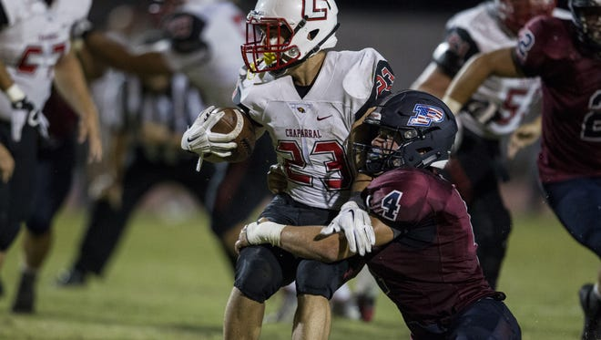 Chaparral's Spencer Greenberg is tackled by Perry's Case Hatch in the fourth quarter on Friday, Sept. 18, 2015 in Gilbert, AZ. Chaparral won the game, 27-17.