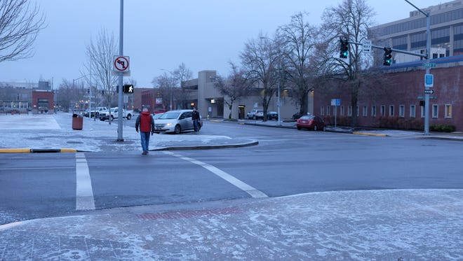 Ice lingered Monday morning in downtown Salem on sidewalks and parking areas.