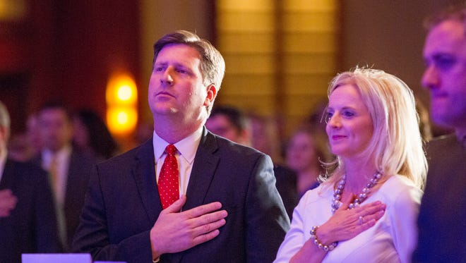 """Phoenix Mayor Greg Stanton with his wife Nicole says pledge of allegiance before Mayor's  fourth """"State of the City"""" speech on April 8, 2015."""