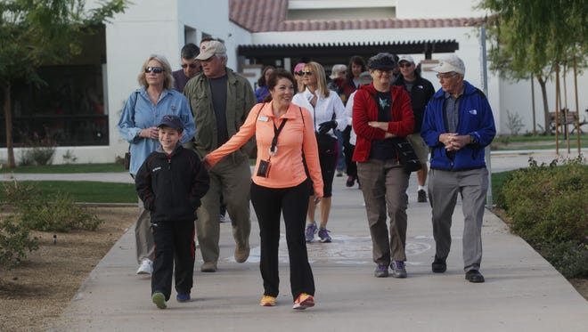 "Residents join La Quinta Mayor Linda Evans on a ""Walk with the Mayor"" from the city's Wellness Center to Old Town Saturday morning. Evans uses the occasional events as an opportunity to talk with residents about the city's agenda and current projects."