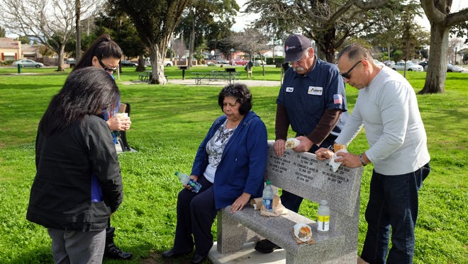 From left, Julie Jaquez, Norma Florez, Katharine Balli Trevino, Edward's mother, Paul Torrecillos and Tony Virrueta pray before sharing a meal in honor of Chief Warrant Officer 2 Edward Balli.