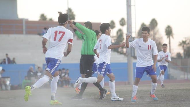 Indio's Ivan Jose celebrates his first goal against La Quinta High School.