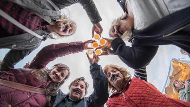In is column, Jeff Baker looks to the future of beer. In this photo, people toast beer at Oktoberfest Vermont last fall.