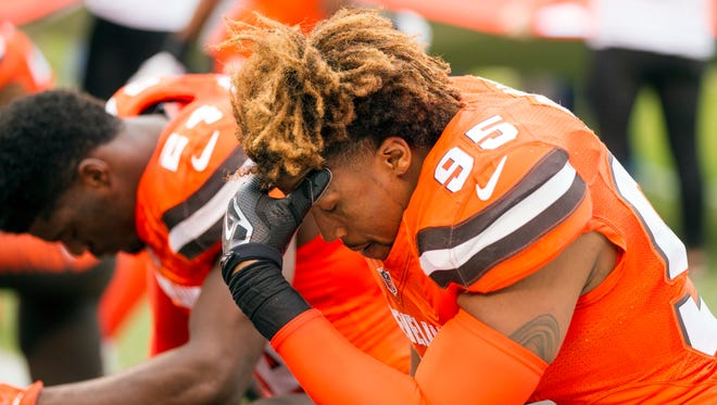 Cleveland Browns outside linebacker Armonty Bryant (95) kneels for a pre-game prayer against the San Francisco 49ers at FirstEnergy Stadium.
