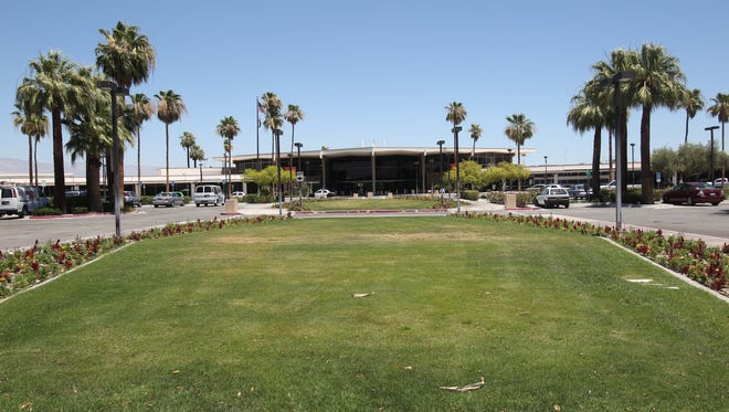 Palm Springs International Airport will hit the pause button for a turf removal project, due to high costs.